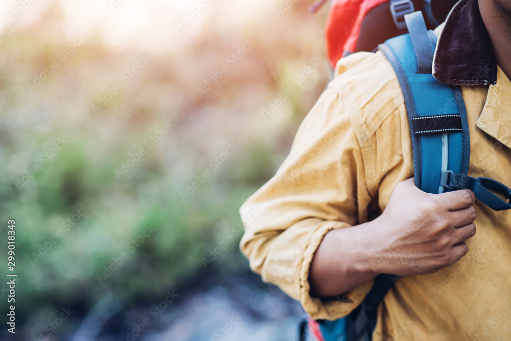 Fototapety, obrazy: close up hand holding backpack man hiking traveling on forest in travel Lifestyle wanderlust adventure with enjoying on nature. Tourist traveler on background valley landscape view. focus to hand.