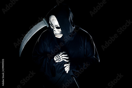 Photo  Grim Reaper ghost coming out of the shadows with a scythe or sickle