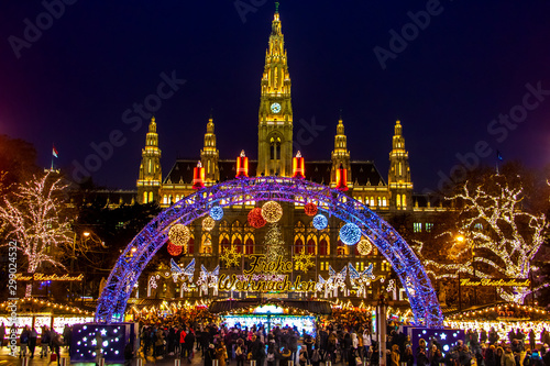 The Illuminating gate in front of the Christmas market by City hall -  Rathaus in night Vienna, Austria Canvas Print