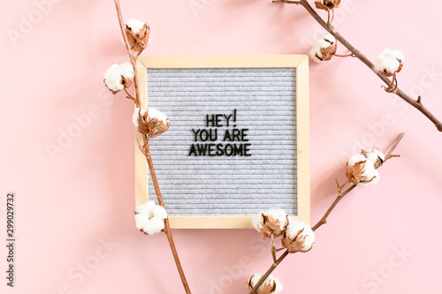 Photo  Cotton branches and letterboard with quote Hey you are awesome