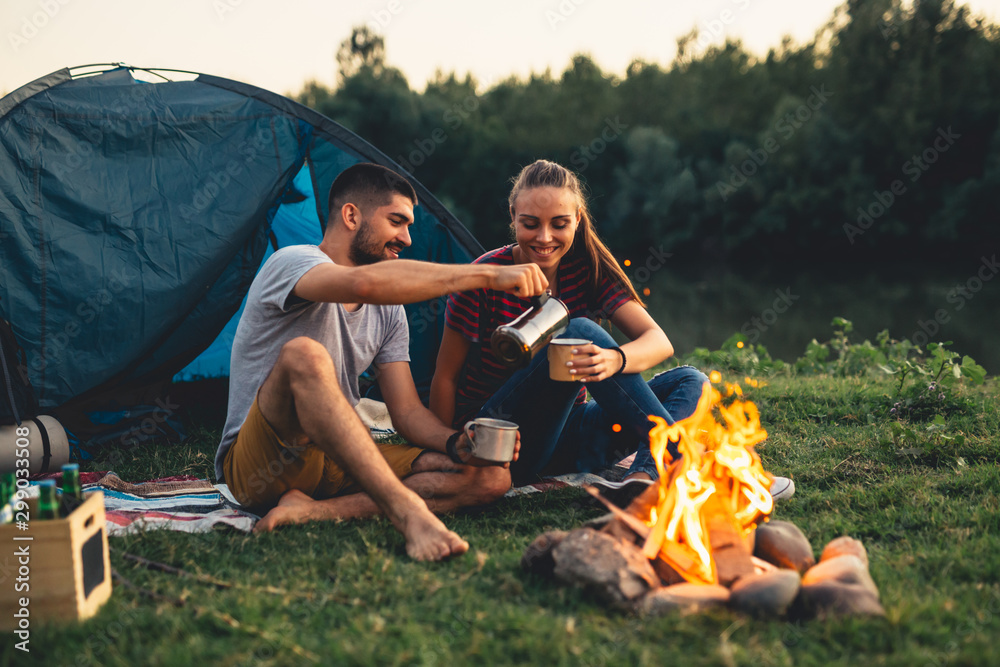 Fototapeta romantic couple on camping by the river outdoors