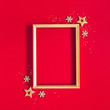 canvas print picture - Christmas composition. Photo frame, golden and red decorations on red background. Christmas, winter, new year concept. Flat lay, top view, copy space