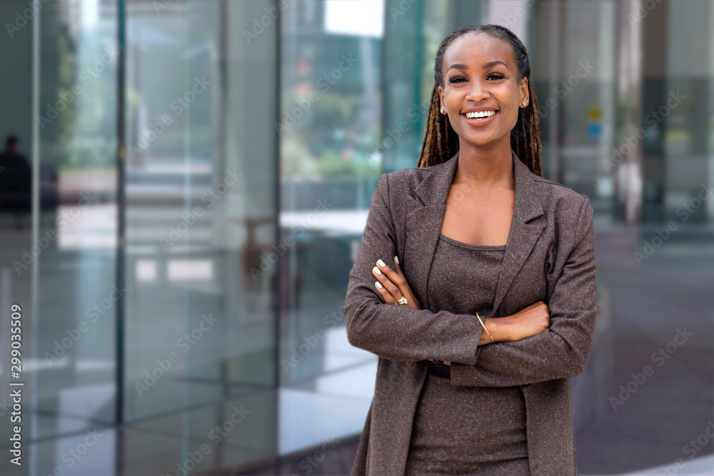 Fototapety, obrazy: Beautiful cheerful african american executive business woman at the workspace office