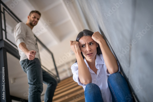 Wife feeling scared after argument with crazy husband Canvas Print