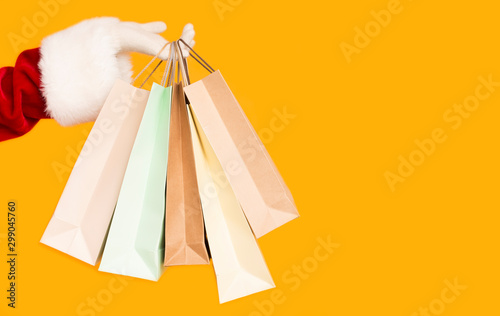 Poster Ecole de Danse Santa holding Christmas shopping bags with presents
