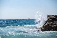 Sea Wave Splashes Over Stone