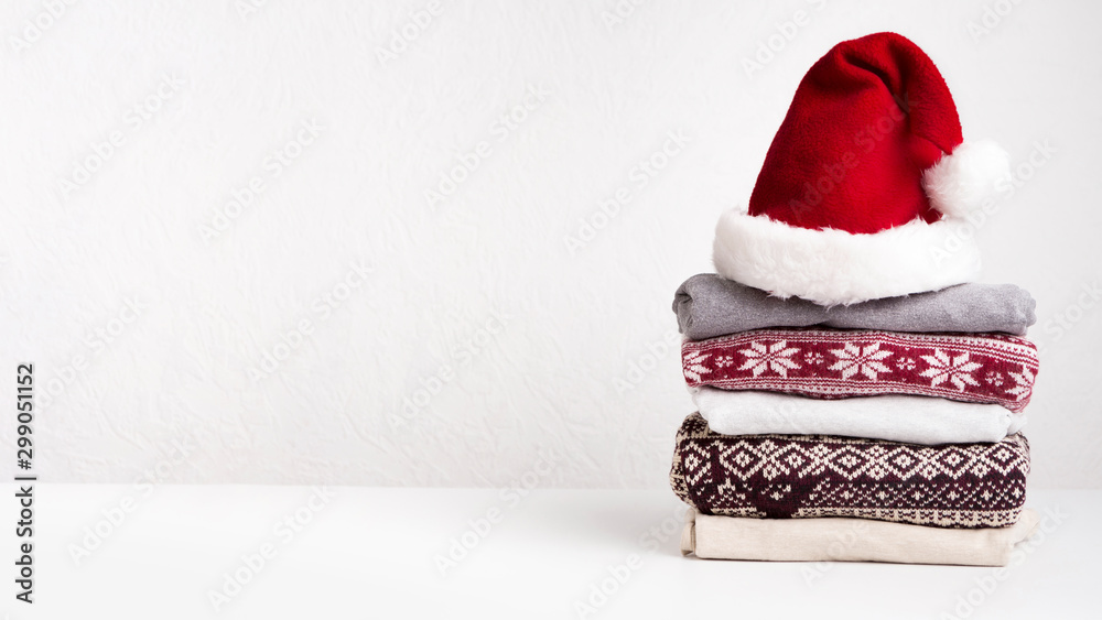 Fototapety, obrazy: Winter holiday knitted sweaters in Santa's hat on white