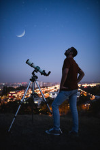 Astronomer With A Telescope Wa...