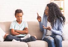 Angry Black Mom Scolding Naugh...