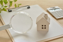 Magnifying Glass And House