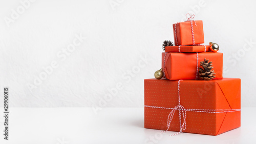 Creative Christmas presents wrapping in red paper on white Wallpaper Mural