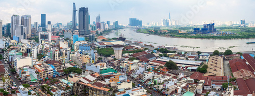 HO CHI MINH, VIETNAM - September 23 2019 : Panorama view of ho chi minh city and Saigon river from District 4 with development buildings, transportation. Vietnam is the fastest growth of the world.