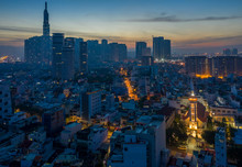 Five O'clock, Early Morning Aerial Urban View Binh Thanh District Of Ho Chi Minh City Featuring A French Colonial Church, Streets And High Rise Buildings And Majestic Sky