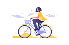 Girl On Bicycle Going By Road