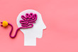 Brain charging and mental rest. Plug and cable leads to plastiline meanders on pink background top view copy space