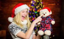 Cute Gift. Winter Holidays Celebration. Happy New Year. Christmas Preparation. All She Wants For Christmas. Cheerful Woman. Xmas Mood. Woman Got Teddy Bear Toy Present. Santa Hat Christmas Accessory