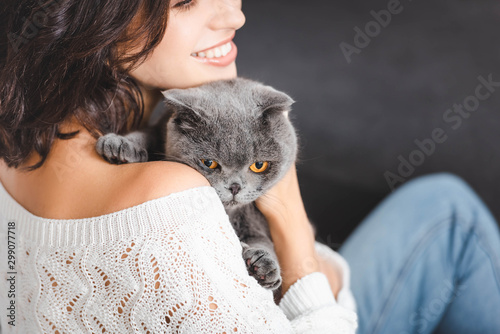 close up of woman with grey scottish fold cat Wallpaper Mural