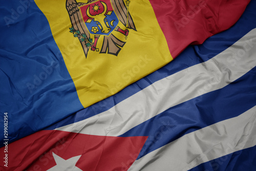 waving colorful flag of cuba and national flag of moldova. Canvas Print