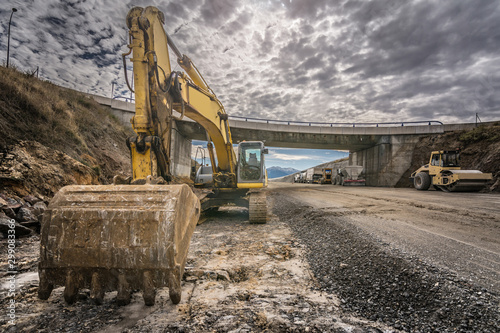Fototapeta Excavator in the construction of a highway obraz