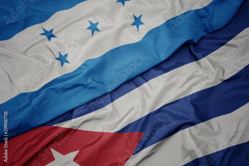 Photo  waving colorful flag of cuba and national flag of honduras.