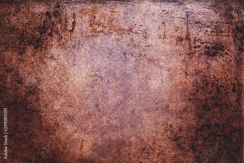 Overhead view scratched grunge sheet of copper metal. Texture with light vignetting.