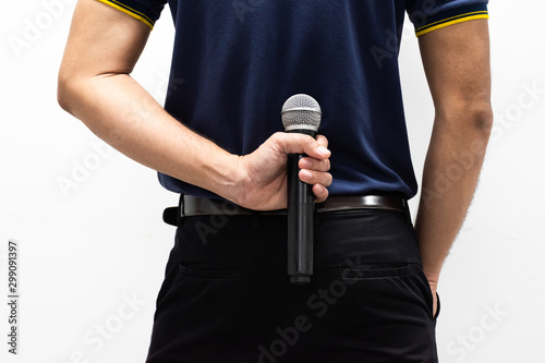 A man with a microphone in his back on white background Wallpaper Mural