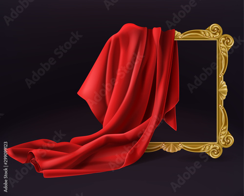 Fotomural  Red silk cloth cover wooden painting frame isolated on black background