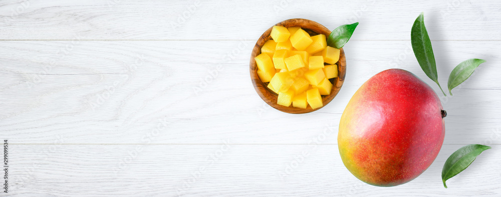 Fototapety, obrazy: Fresh mango exotic health product with leaf on white background. Mangos wide banner or panorama fruit top view.