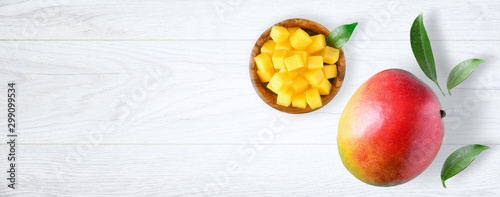 Fresh mango exotic health product with leaf on white background. Mangos wide banner or panorama fruit top view. - 299099534