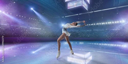 Figure skating girl in ice arena. - 299102179