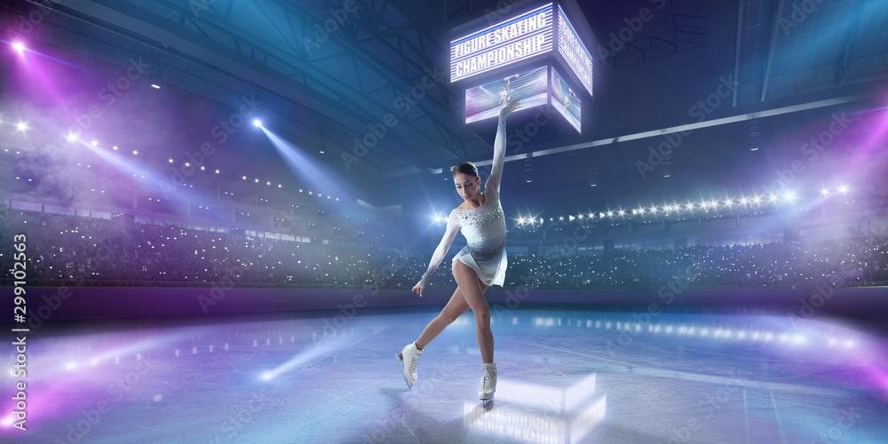 Fototapety, obrazy: Figure skating girl in ice arena.