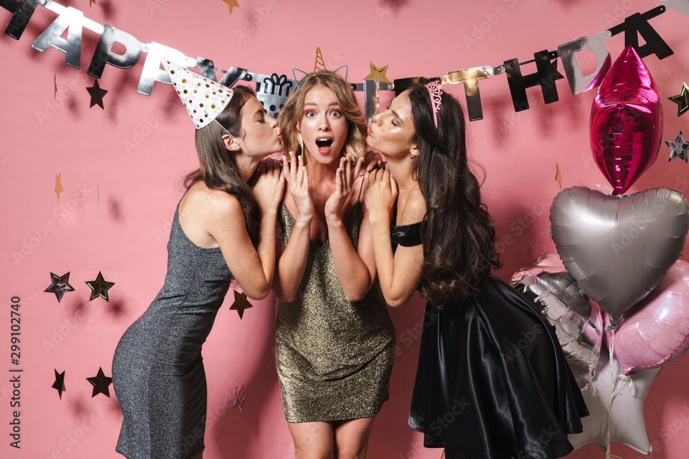 Fototapety, obrazy: Three cheerful pretty girls wearing dresses celebrating birthday