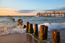 Wooden Pier And Breakwater Dur...
