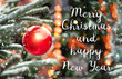 Merry christmas and happy new year greeting card. celebration concept. Red balls on fir branches, winter snowy backdrop. festive winter holiday background. soft selective focus