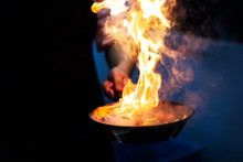 Chef Cooking With Flame In A F...