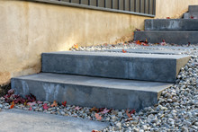 Precast Concrete Steps Provide A Safe And Comfortable Landscaping Solution To Address The Steep Grade Between Two Houses.