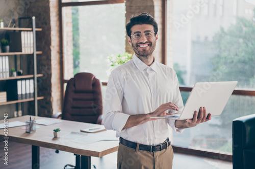 Fototapety, obrazy: Portrait of positive confident smart middle eastern entrepreneur man hold laptop using feel success have online seminar training self-development in loft work office