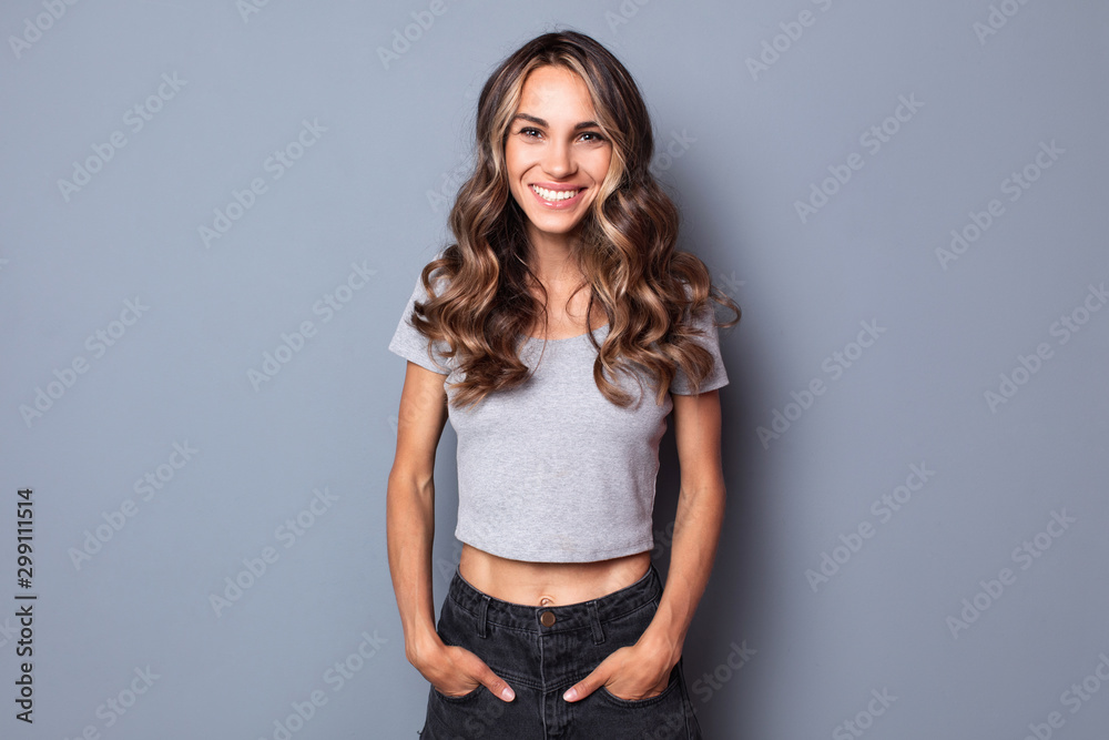 Fototapety, obrazy: Isolated portrait of smiling woman.