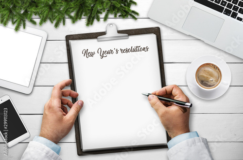 Man writing New Year's resolutions, background Canvas Print