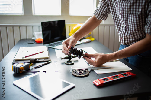 Fotomural  Engineering is checking the metal wheel for future car assembly.