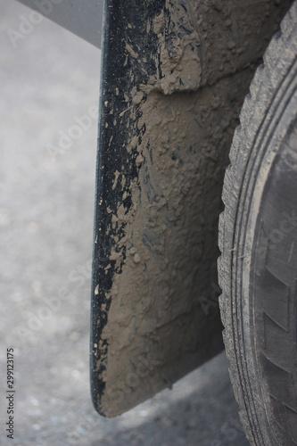 Leinwand Poster Dirty mud flaps on vehicle