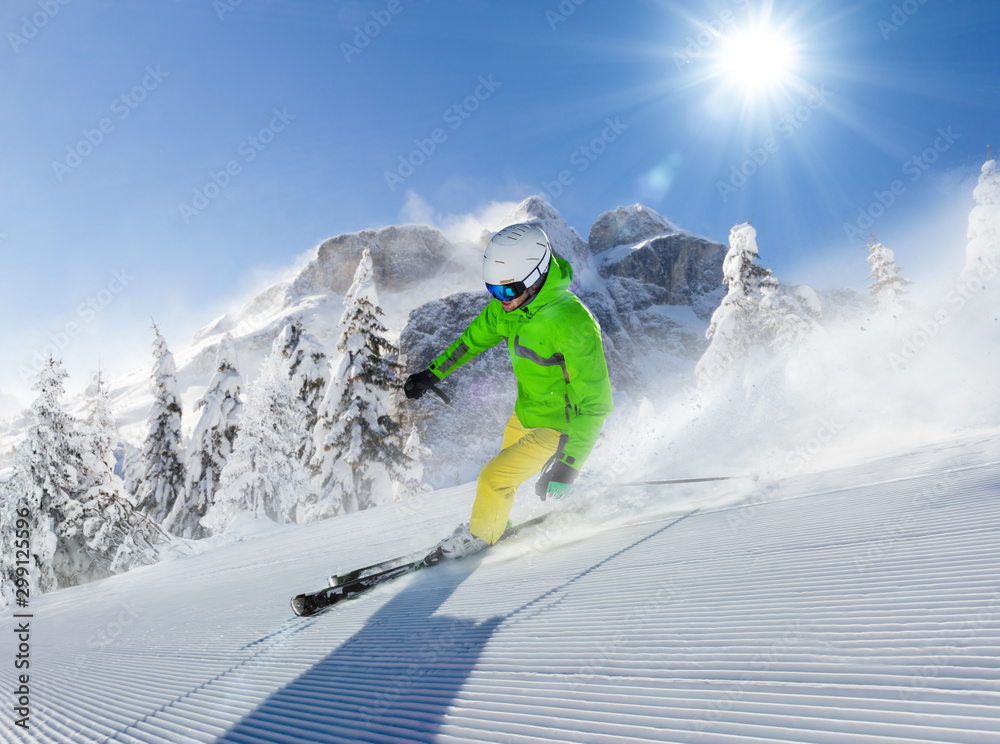 Fototapety, obrazy: Young man skier running down the slope in Alpine mountains