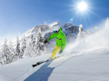 Young Man Skier Running Down T...