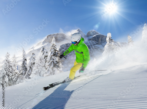 fototapeta na drzwi i meble Young man skier running down the slope in Alpine mountains