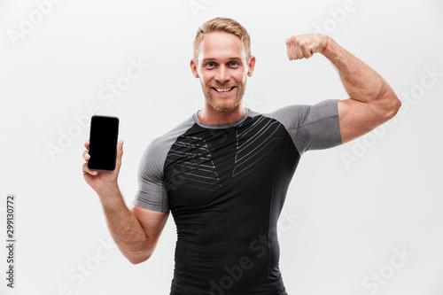 Obraz Portrait of a smiling fit sportsman - fototapety do salonu