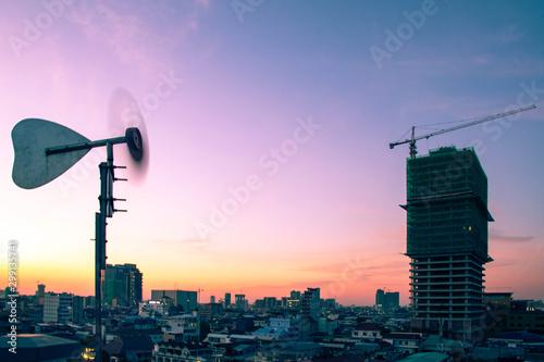 Pinturas sobre lienzo  Phnom Penh city at dust, view of new develop under construction condo with crane