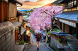 canvas print picture - Woman traveler with backpack walking at Historic Higashiyama district in spring, Kyoto in Japan.
