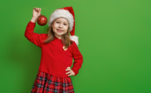Girl In Santa Hat On Color Bac...