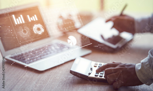 Fotomural  business man holding hand on calculator