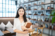 Education Study Abroad,Asian Chinese Student Girl Holding Book  Looking To Camera, Happy Mood Smiling Broadly ,she Is Young Female Student Who Study In The School Library Copy Space Vintage Tone